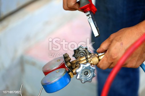 962280084 istock photo manometers measuring equipment for filling air conditioners,gauges. 1071657052