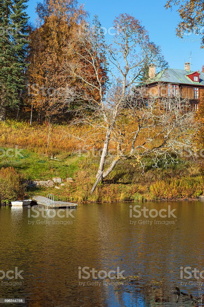 Manor house on a hill by a lake royalty-free stock photo