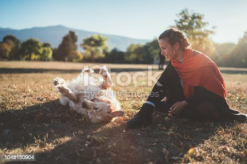Woman with dog in the autumn park