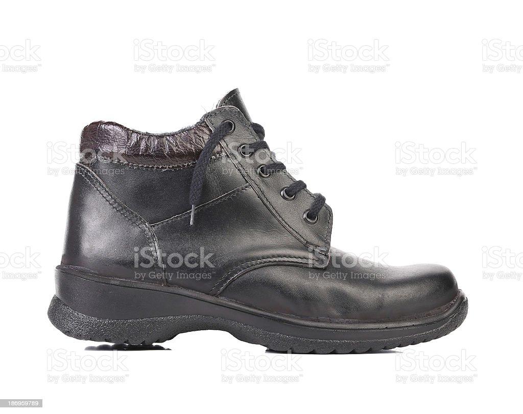 Man's black shoe. royalty-free stock photo