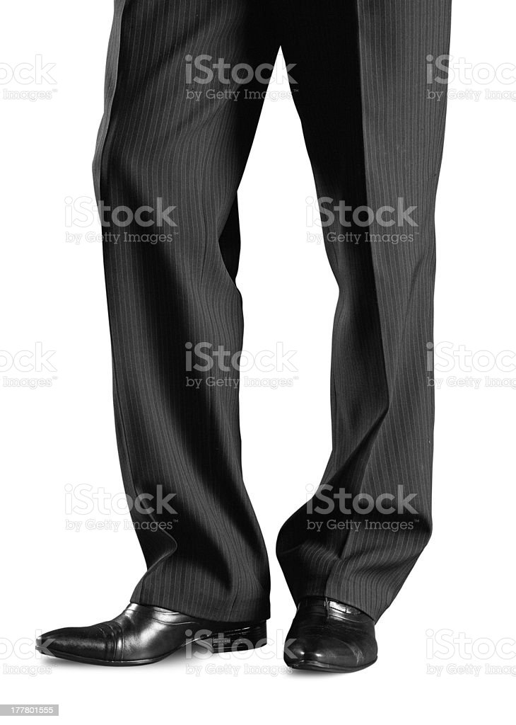A man's bottom half in dress slacks and dress shoes stock photo