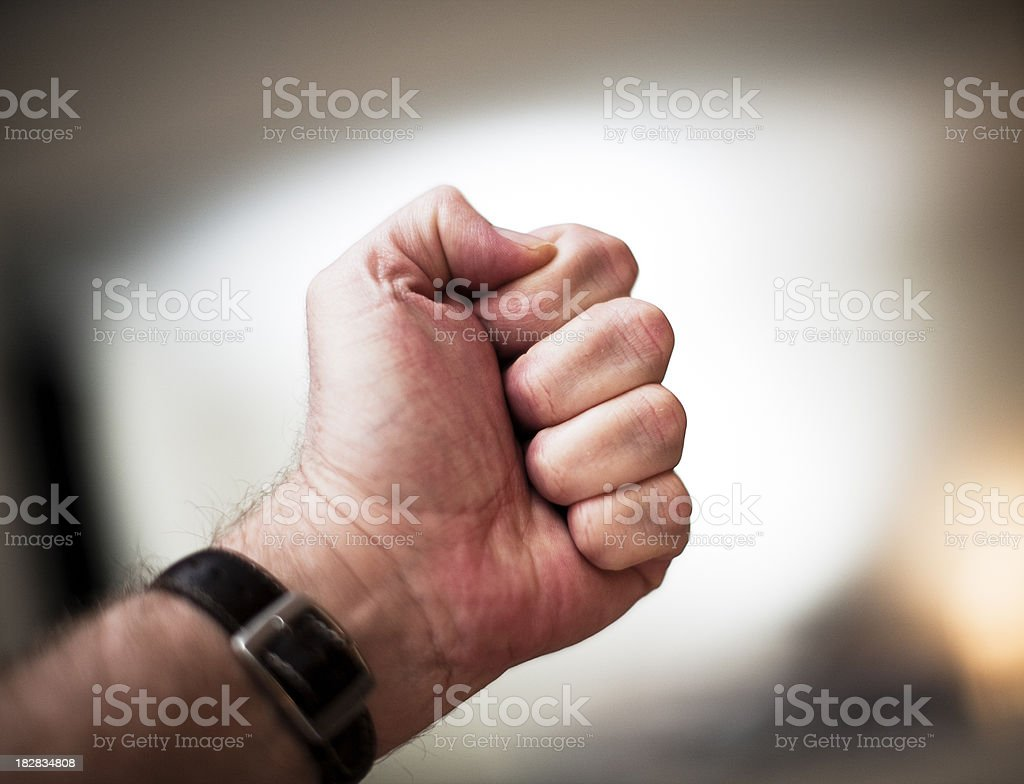 Man's clenched fist royalty-free stock photo