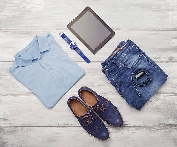 Man's clothing, watch and tablet stock photo