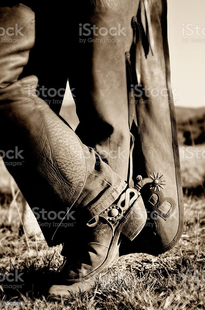 Man's Cowboy Boots and Leather Chaps, Sepia Toned royalty-free stock photo