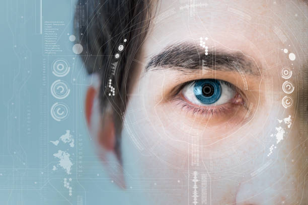 man's eye and technological concept, smart contact lens stock photo