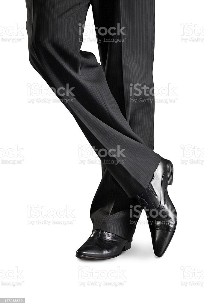 Man's feet in black shoes stock photo