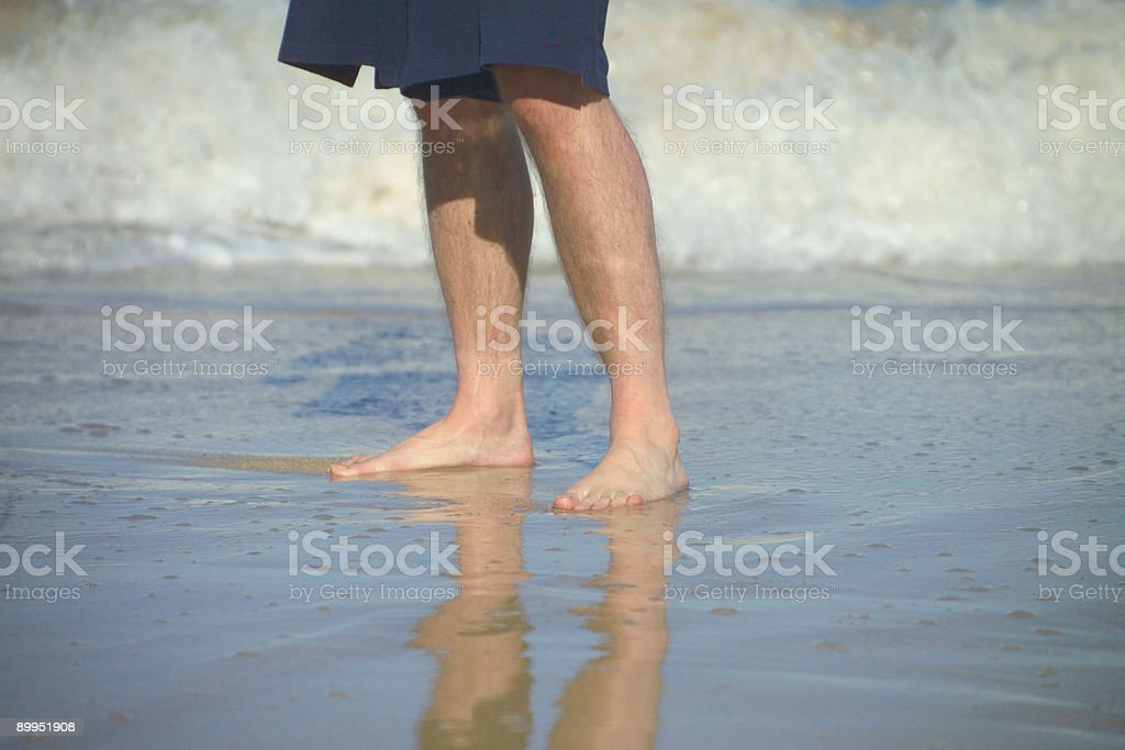 Man's feet in the ocean royalty-free stock photo