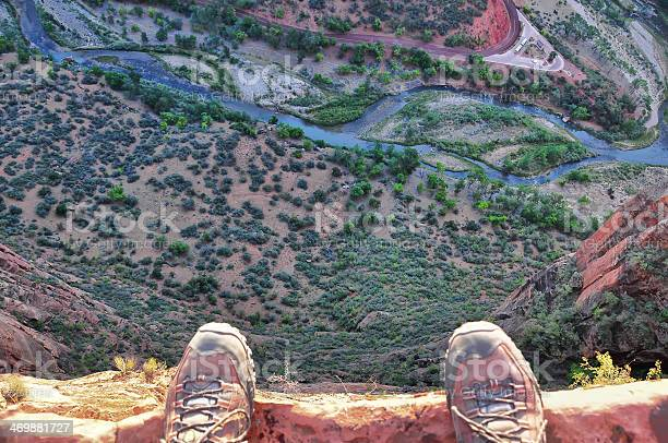 Mans Feet On The Edge Of Rock Cliff Stock Photo - Download Image Now