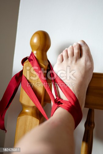 Man's foot tied to bedpost
