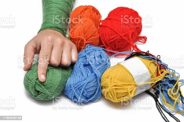 Mans hand and colored yarn isolated on a white backgroundcrochetcopy picture id1165348148?b=1&k=6&m=1165348148&s=612x612&h=ypuxuubr6s4fq6d5f0oybobfpfqudccr9r5kpd9aooa=