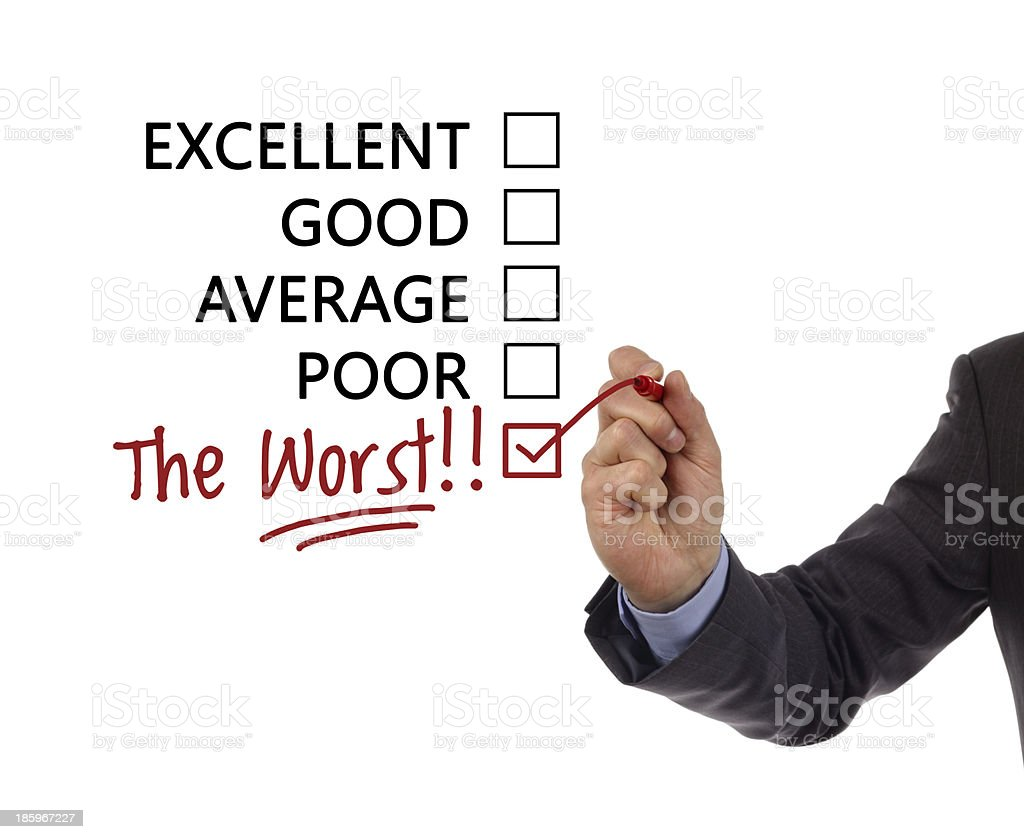 """A man's hand checking the worst on a list of options Tick placed in a new hand written """"the worst"""" checkbox on customer service satisfaction survey form Achievement Stock Photo"""
