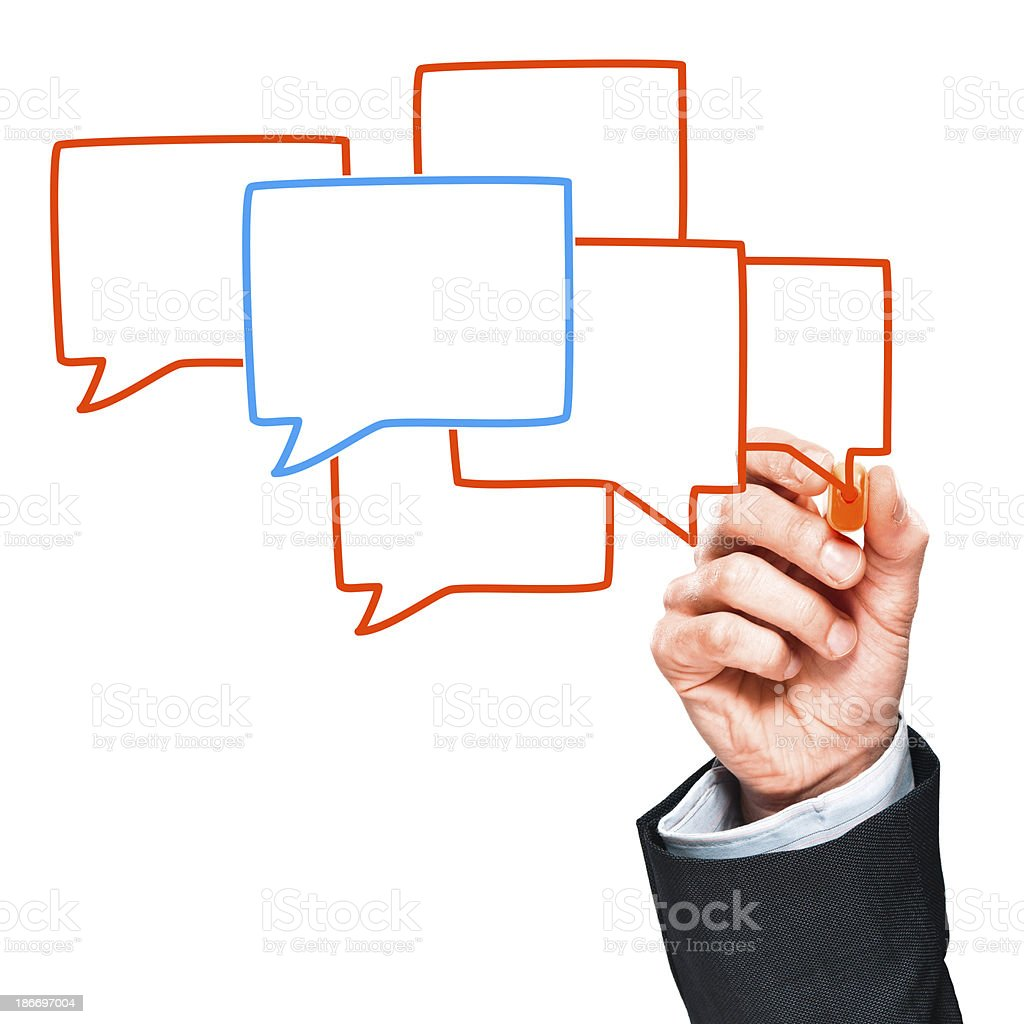Man's hand drawing handwritten speech bubbles in orange and blue royalty-free stock photo