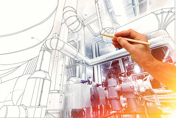 man's hand draws a design of factory stock photo