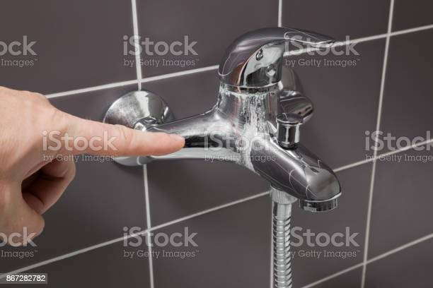 Mans hand finger pointing to calcified water tap in the bathroom picture id867282782?b=1&k=6&m=867282782&s=612x612&h=yvbvgwtm7h1rm9ofbjnkyk9tzisvcbxixqohe kd2rm=