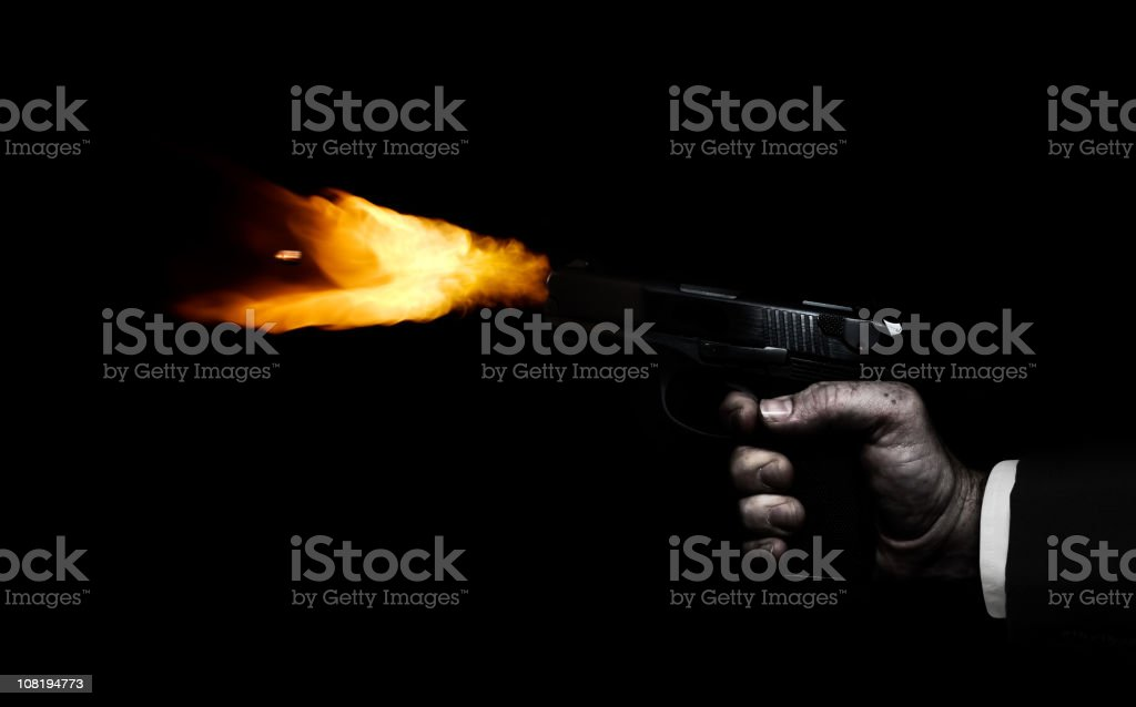 Man's Hand Firing Gun, On Black Background stock photo