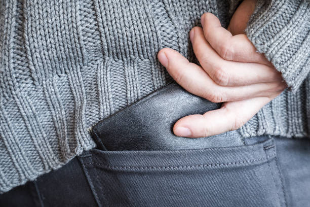Man's hand holding a black money wallet in his jeans pocket. Man's hand holding a black money wallet in his jeans pocket. allowance stock pictures, royalty-free photos & images