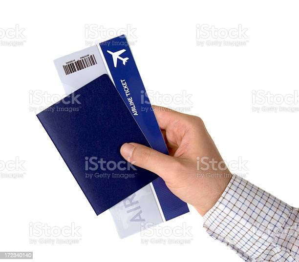 Mans hand holding a blue passport and airplane ticket picture id172340140?b=1&k=6&m=172340140&s=612x612&h=o3wjxtwxsz4rwzv4 ta8sga7vdyhssc8w61ivlbfq9c=