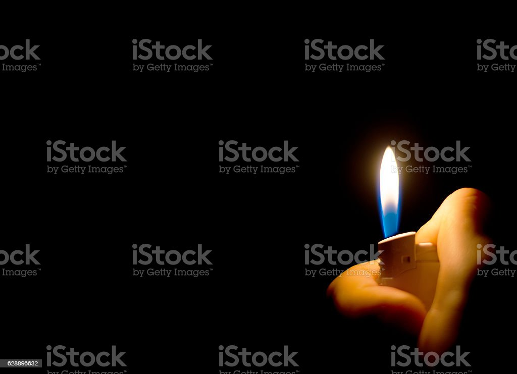 Man's hand holding a lighter. Place for text. – Foto