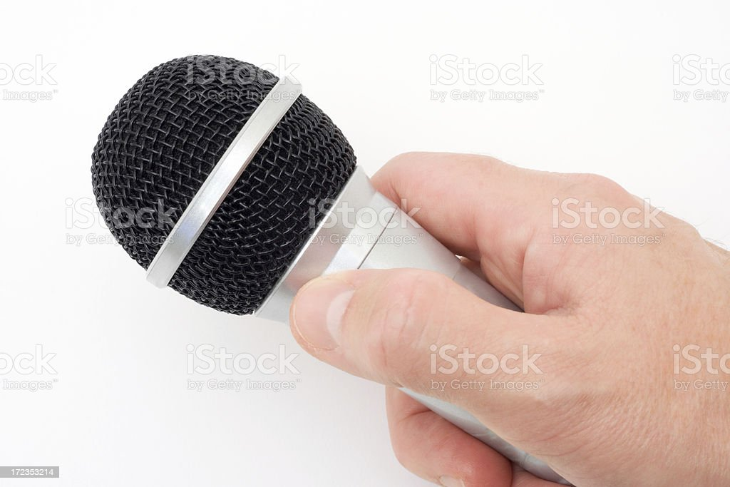Man's Hand Holding a Microphone royalty-free stock photo