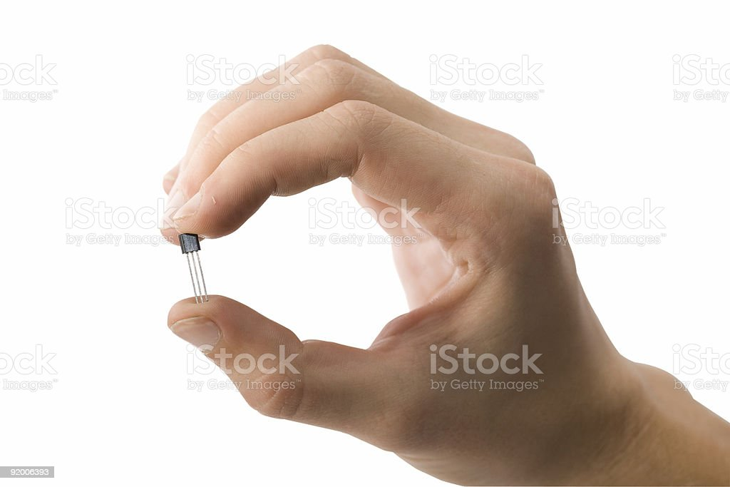Man's hand holding a transistor isolated stock photo
