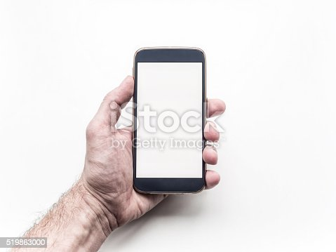 istock Man's hand holding and using mobile smartphone on white background 519863000