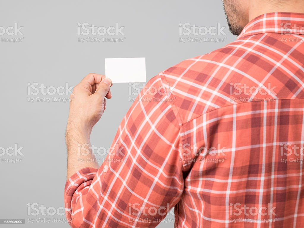 Man's hand holding blank business card royalty-free stock photo