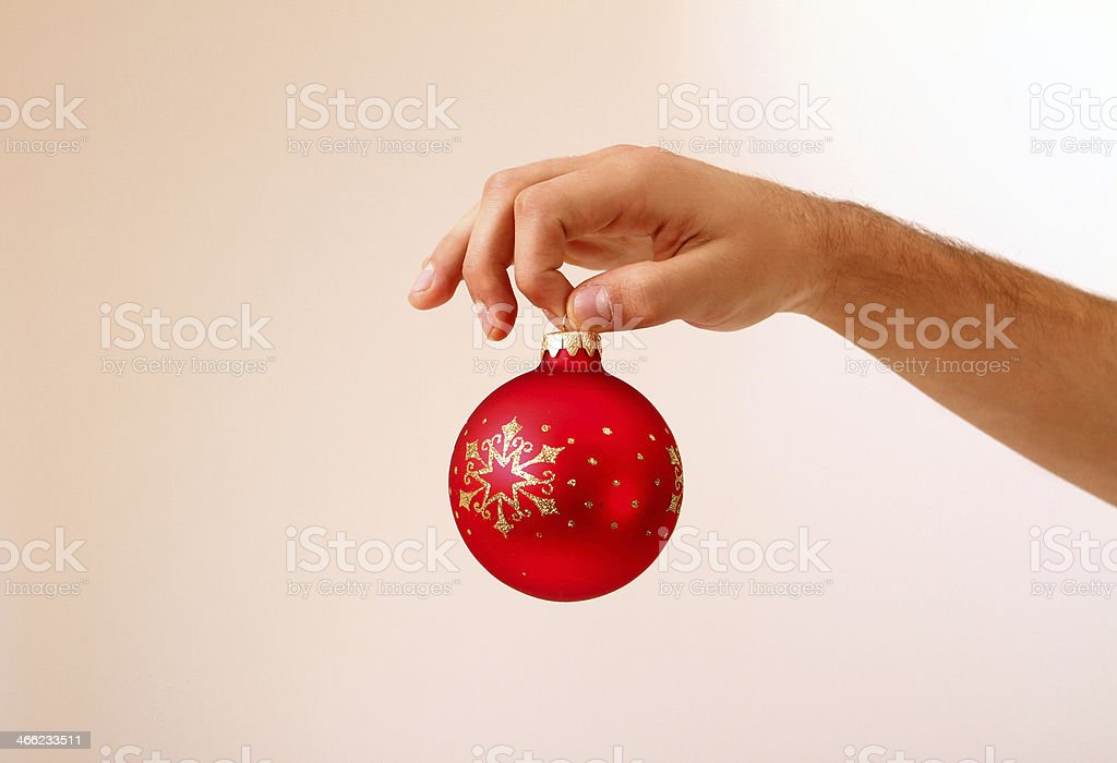 Man's hand holding Christmas ball isolated royalty-free stock photo