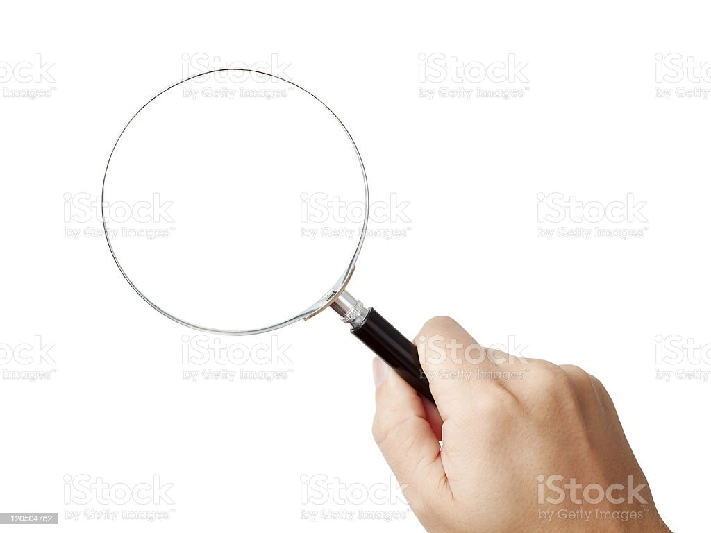 Man's hand, holding magnifying glass royalty-free stock photo