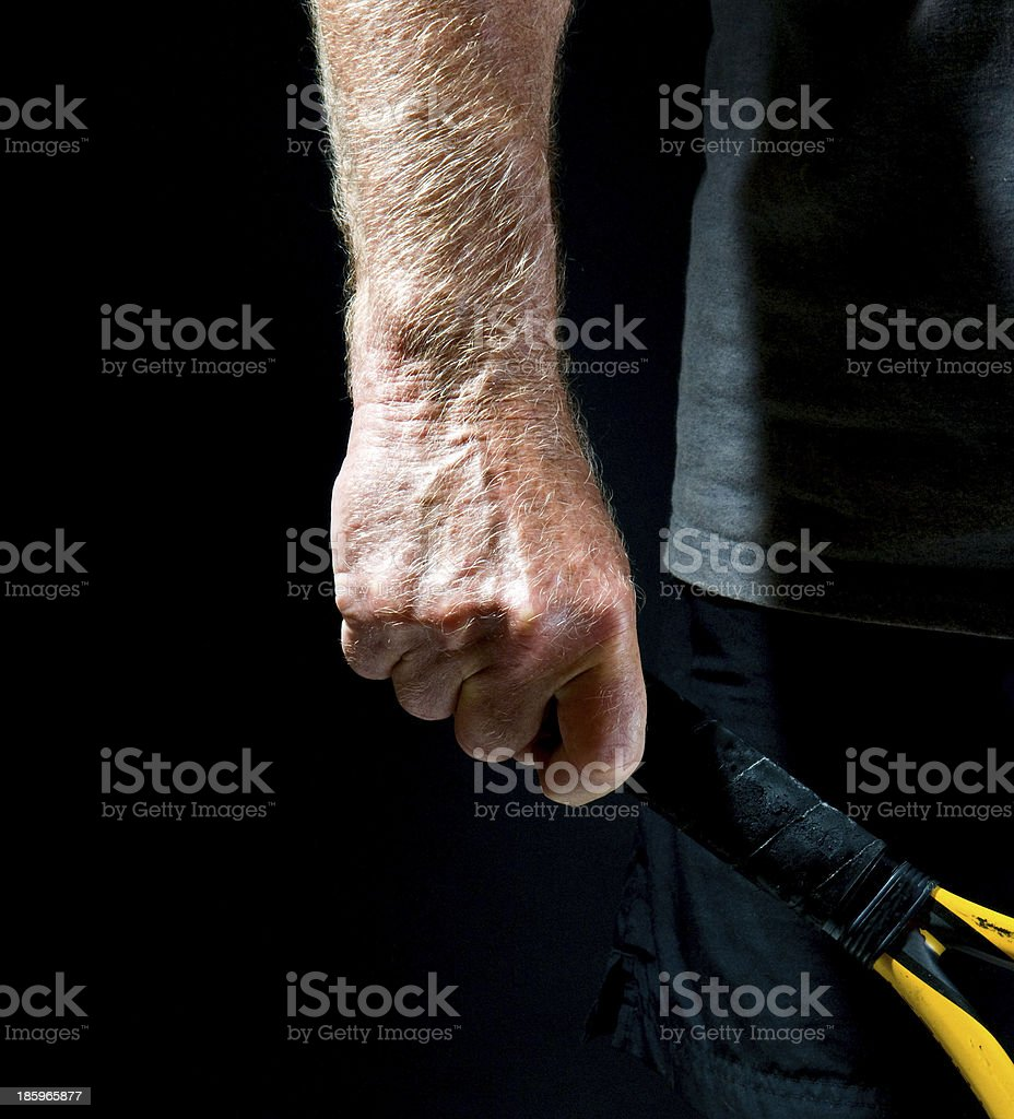 man's hand holding tennis racket stock photo