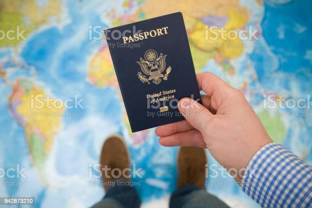 Mans hand holding us passport map background ready for traveling open picture id942873210?b=1&k=6&m=942873210&s=612x612&h=bmobz9fqvpie8aecbg wn7bc216rzkbucll01ahzghm=