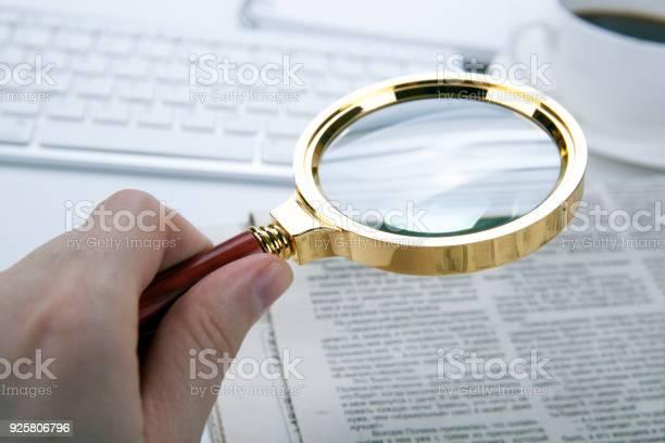 Mans hand holds a magnifying glass over a newspaper font picture id925806796?b=1&k=6&m=925806796&s=612x612&h=eyygflgif5bkeoprndimqhofqivpdv0abkm7odxj ma=