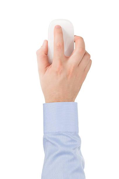 La main de homme en chemise moderne en verre Souris tactile sans fil. - Photo