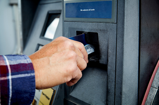 Mans Hand Inserting Credit Card At Atm At Gas Pump Stock Photo - Download Image Now
