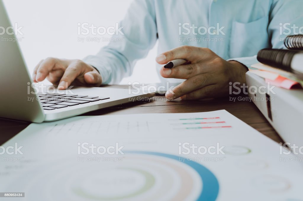 Man's hand is pressing a computer keyboard. It's a technology work. To make the work easier. Take your screen to put on advertising. stock photo