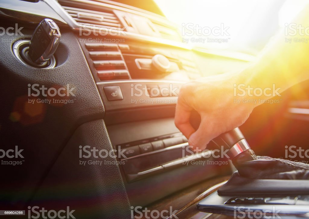 A man's hand on an automatic gearbox. Automatic shift transmission. stock photo