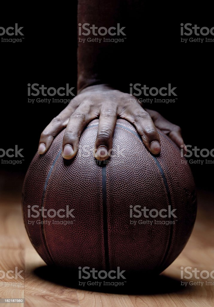 Man's hand on basketball stock photo