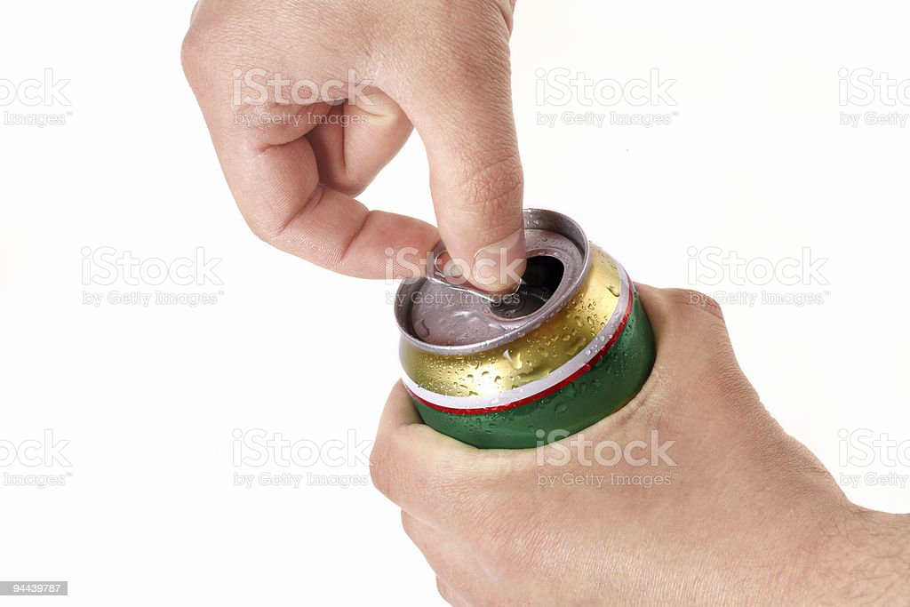 Man's hand opening aluminum beer can stock photo