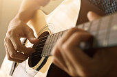 istock Man's hand playing acoustic guitar 1190645702
