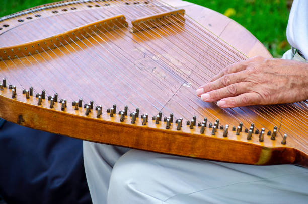 Cтоковое фото Man's hand plays an ancient spiked string musical instrument bandura