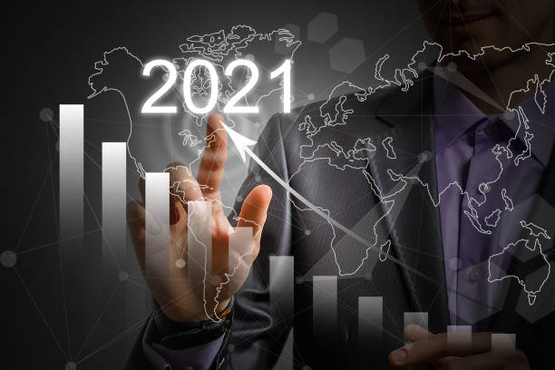 Man's hand pointing graph of success in 2021 year. Growing business concept stock photo