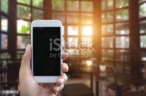 534217898istockphoto Man's hand shows mobile smartphone in vertical position 578599214