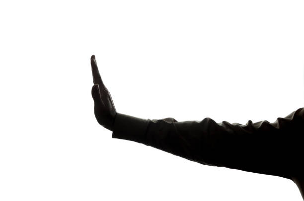 man's hand shows stop, denial, disagreement - silhouette - railway signal stock photos and pictures