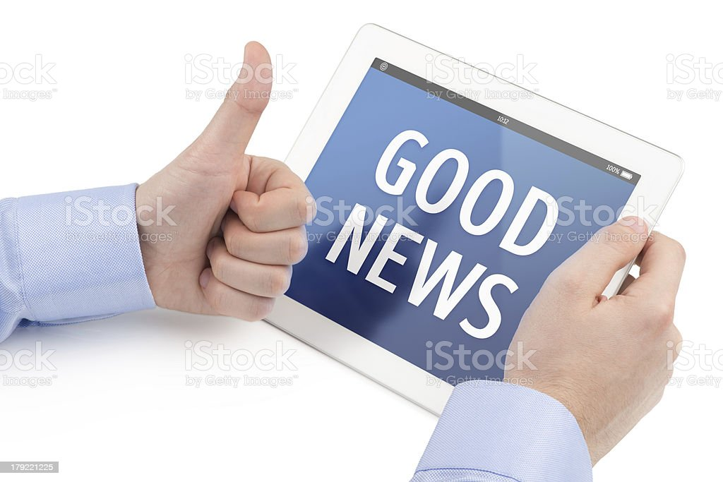 Mans hand shows thumbs up gesture at tablet computer screen. stock photo