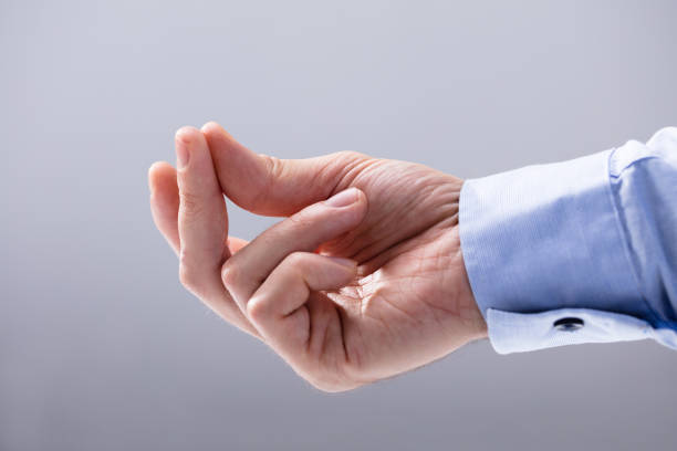 Man's Hand Snapping His Finger Close-up Of Man's Hand Snapping His Finger Against White Background snapping stock pictures, royalty-free photos & images