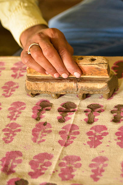 man's hand traditional wood block printing, india - woodcut stock photos and pictures