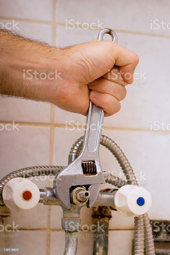 Man`s hand with spanner royalty-free stock photo