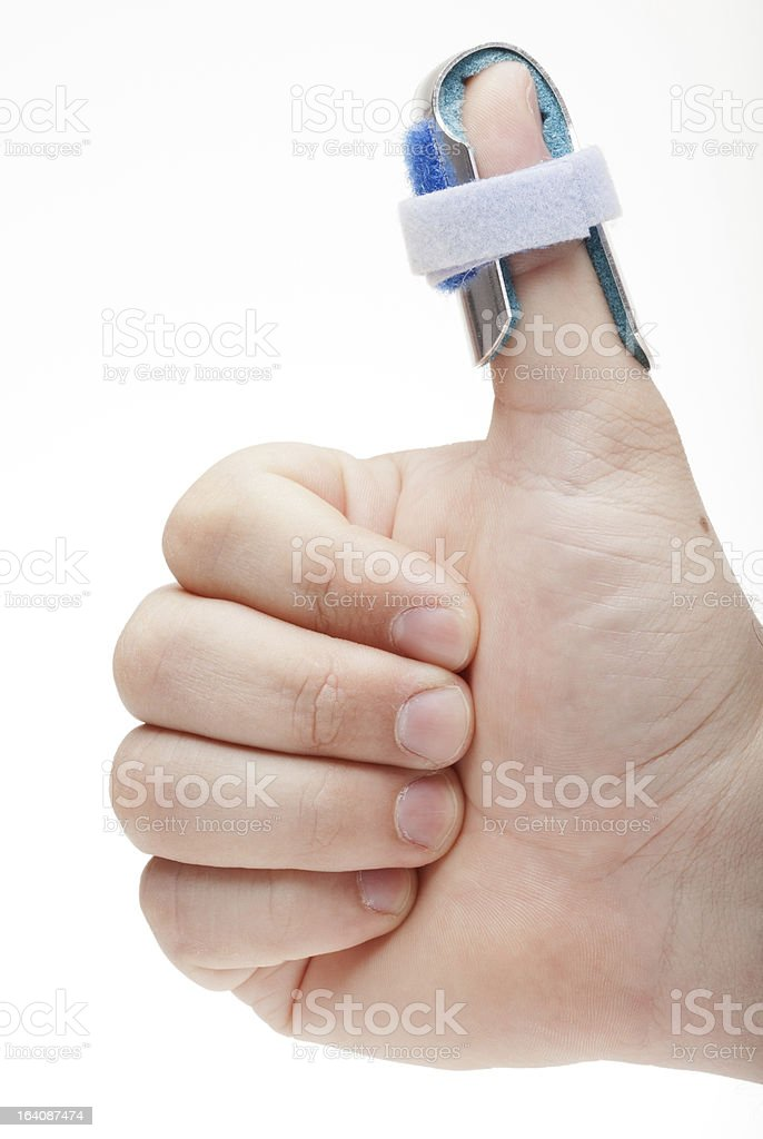 Man's hand with thumb spint stock photo