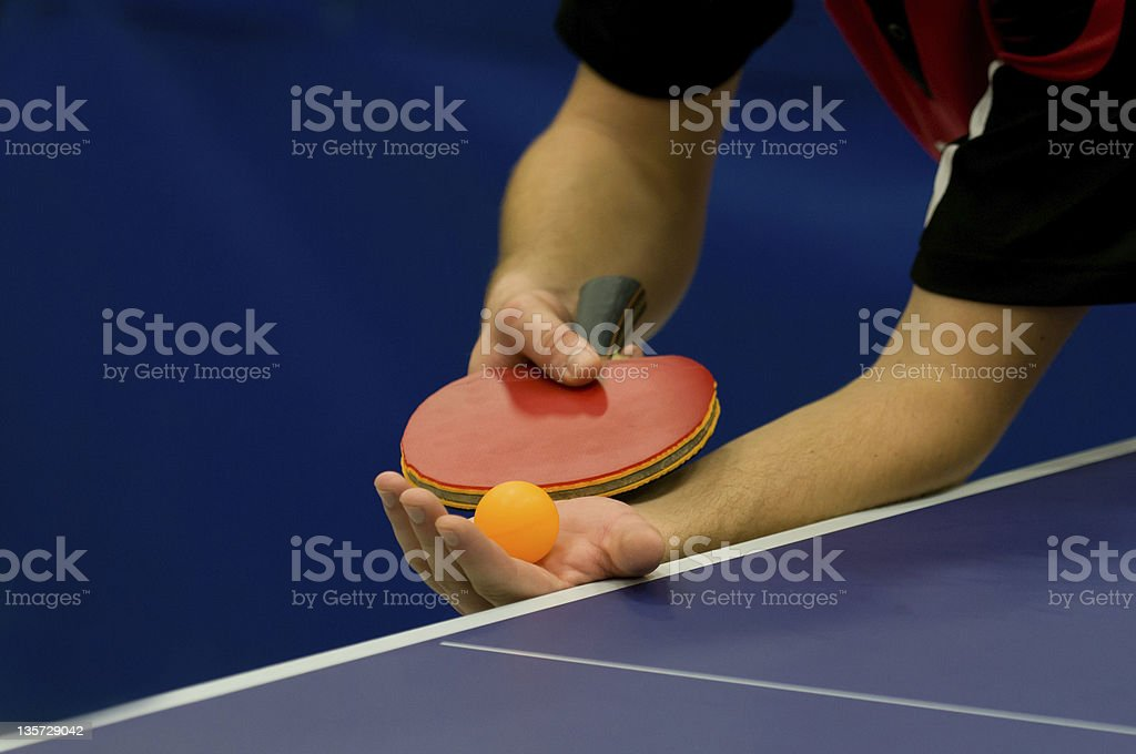 Mans hands about to serve a game of table tennis stock photo