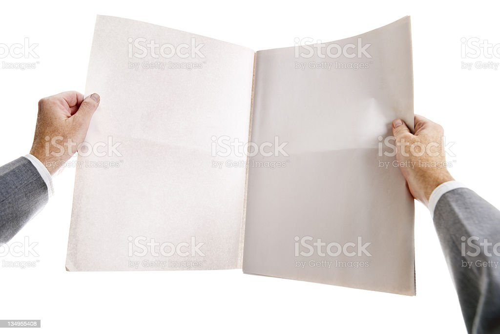 Man's hands clutch blank, open newspaper tightly. stock photo