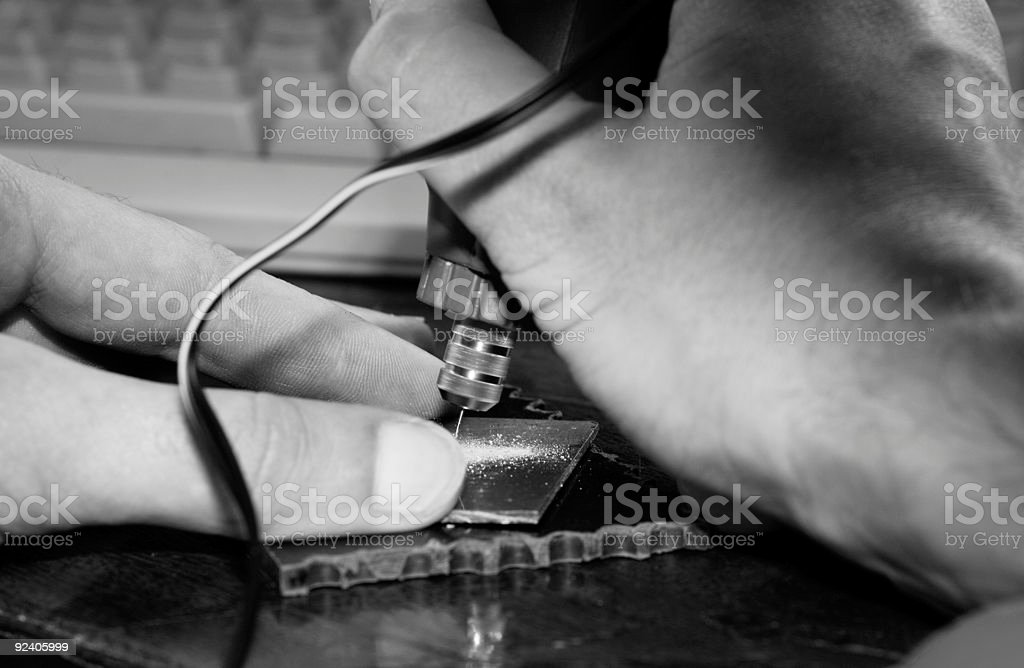 Man's hands drilling with mini-drill royalty-free stock photo
